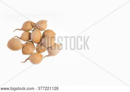 Tamarind Tropical Fruit - Tamarindus Indica. White Background