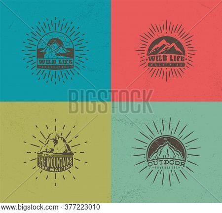 Mountain Emblems. Set Of Four Vector Colored Vintage Badges, Mountaineering Camp And Adventure Touri