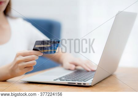 Hand Of Young Woman Holding Credit Card Buying Shopping Online With Laptop Computer, Girl Purchase A