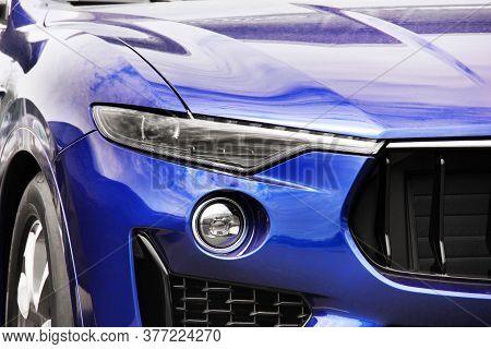 Part Of A Blue Luxury Car. Car Headlights. Luxury Headlights