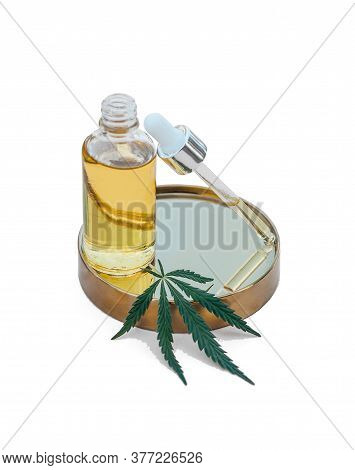 Glass Bottle And Dropper Cbd Oil, Thc Tincture And Cannabis Leafs On Isolated White Background. Labo