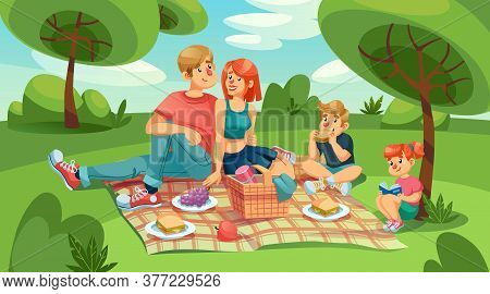 Happy Loving Family Kids On Picnic In Green Park. Mother, Father, Daughter And Son Rest Outdoor Toge