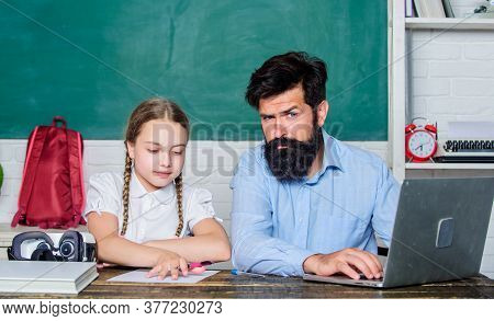 Man Bearded Pedagogue Teaching Informatics. Study Online. Homeschooling With Father. Find Buddy To H