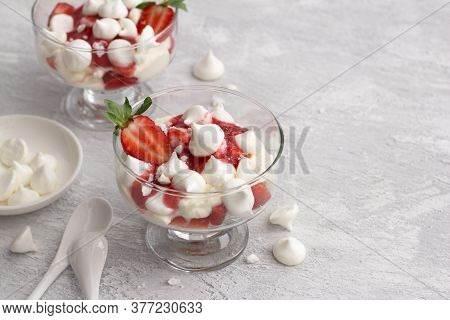 Eton Mess, Traditional English Dessert, Strawberry With Cream, Meringue And Strawberry Sauce On Ligh