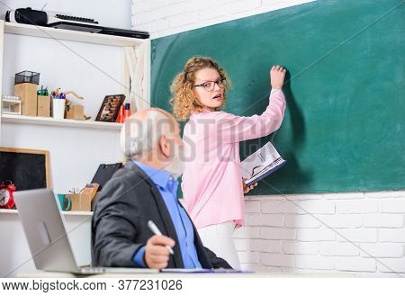 School Education. Student Learning In Auditorium. Senior Teacher And Woman At School Lesson. Pass Ex