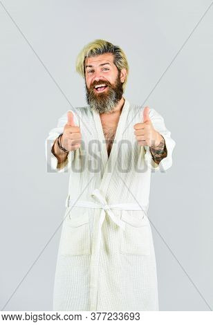Hygiene And Spa. Man In Bathrobe In Bathroom. Spa Resort. Hotel Apartments. Bearded Guy Wearing Whit