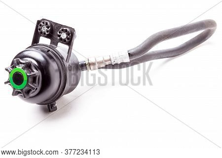 Car Spare Part - Used Plastic Black Tank Of Power Steering Oil Fluid On A White Isolated Background