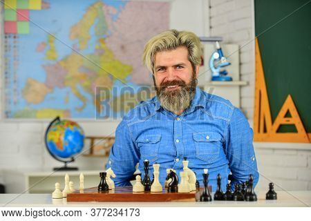 Playing Chess Develops Brain Functioning. Man Hold Chess Piece. Concentrated Man Developing Chess St