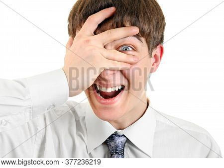 Cheerful Teenager Look Through His Fingers On The White Background Closeup