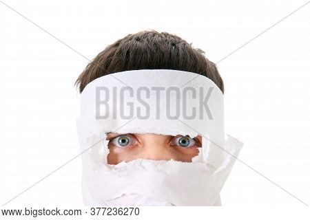 Man Wrapped The Face In A Paper On The White Background Closeup