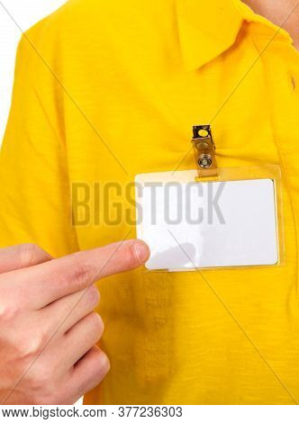 Person Shows A Blank Badge On The Shirt Closeup