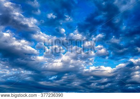 Dramatic Cloudscape Background With A Blue Sky
