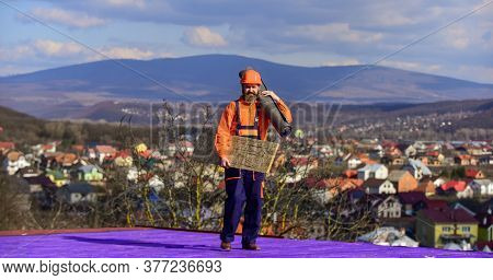 Roofer Contractor Laying Rooftop With Protective Helmet. Man Roofer Inspecting Damaged Roof. Qualifi