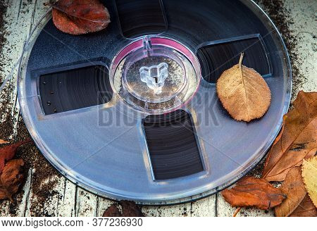 Vintage Reel With A Tape On The Old Dirty Table Outdoor Closeup