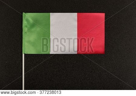 Tricolor Italian Flag Green White Red On Black Background. Table Flag Of Italy.