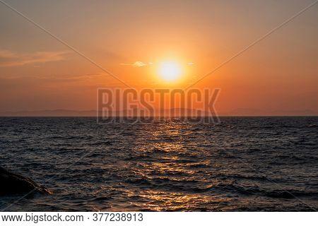 Sunrise, Sunset. Twilight, Dusk Sky Over Sea Water, Mountain Silhouette