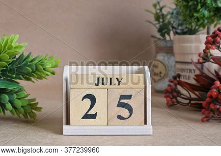 July 25, Vintage Natural Calendar Design With Number Cube.