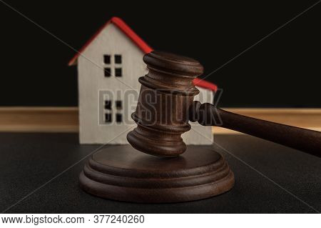 Judges Hammer On Background Of Model House. Settle House Dealing Lawsuit. Confiscated Housing. Conce