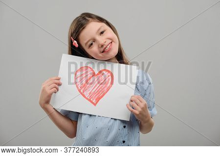 Girl Holding Valentine Greeting Card With Love Confession