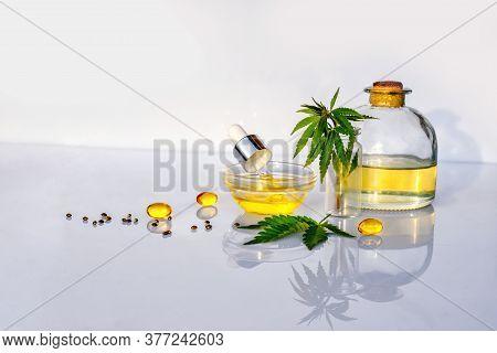 Glass Bottle With Cbd Oil, Thc Tincture And Hemp Leaves On White Background Lab. Medical Marijuana P