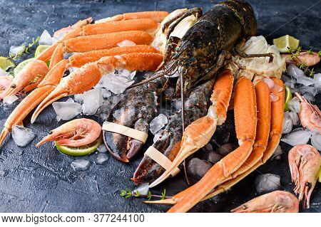 Delicious Fresh Fish And Seafood On Dark Vintage Background. Fish, Clams And Shrimps With Aromatic H