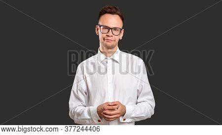 Skeptic Man Portrait. Stupid Joke. Judging Guy With Sarcastic Smile Isolated On Black. Confident Ner