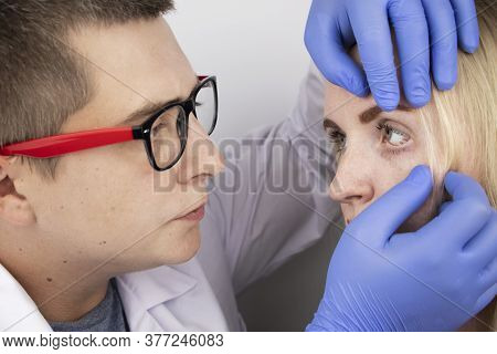 An Ophthalmologist Examines A Woman Who Complains Of A Burning Sensation And Pain In Her Eyes. Eye F