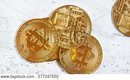 Overhead View, Golden Commemorative Btc - Bitcoin Cryptocurrency - Coins Scattered On White Stone Bo