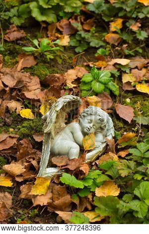 Angel On Graveyard For Children With Leaves