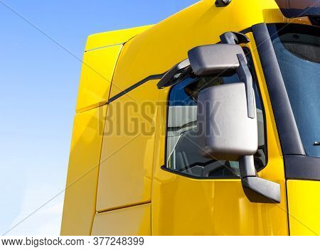 Modern, Streamlined Truck Cab With Good Aerodynamics With A Rearview Mirror. Yellow Truck Cab, Backg