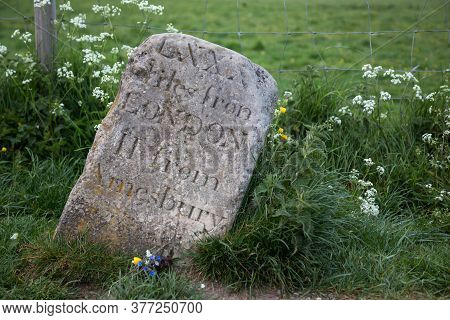 Old Milestone At Stonehenge, Uk. Showing Distance To London And Amesbury In Roman Digits
