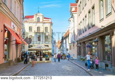Tallinn, Estonia - July 14, 2019: Tourists Walking By The Street At Old Town Of Tallinn.