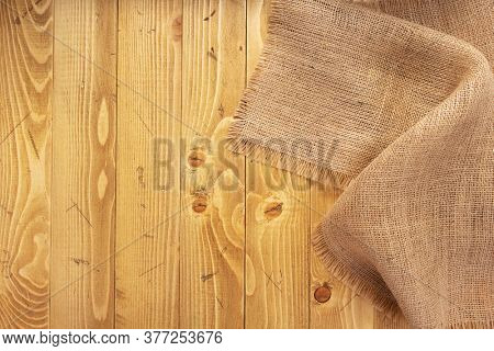 burlap hessian sacking texture on old wooden background, table surface