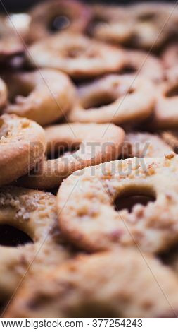Lots Of Cookies And Biscuits Background. Sweet Chocolate Chips Biscuits And Cookies Texture Backgrou