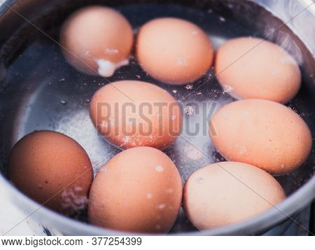 Boiled Eggs In Warm Water After Boiling In Stainless Pot To Let Them Cool Down Before Peeling , Cook