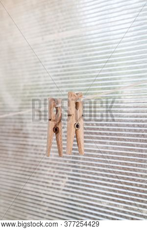 Group Of Clothespin For Clothes Are On Clothesline Rope. Close Up View