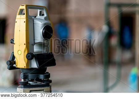 Engineer Site Survey With Laser Tripod Machine In Site Construction Background