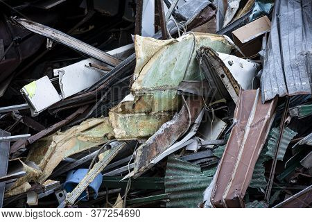 Close-up Of A Dense Pile Of Mainly Broken Scrap Metal, Torn Insulation Material, Cardboard And Cable