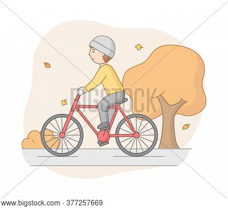 Autumn Weekend Time Leisure Concept. Young Woman Rides Bicycle In The Park. Active People Do Sport A