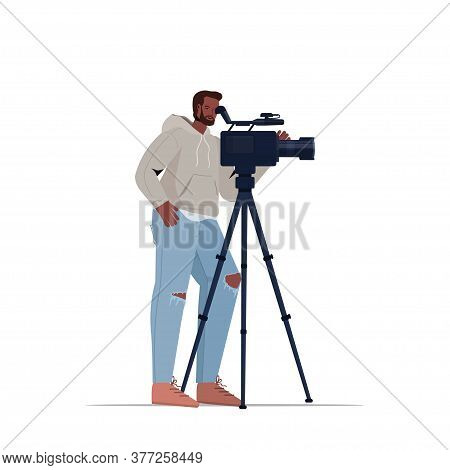 African American Television Operator Using Video Camera On Tripod Cameraman Looking Through Camcorde