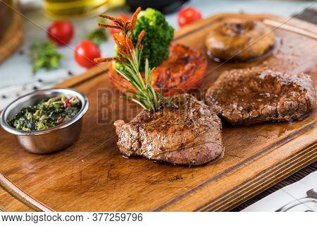 Tenderloin Steak Roast Beef On Wooden Cutting Board On Wooden Background
