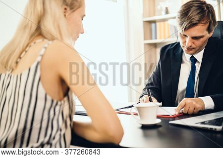 The Interview Scene With The Interviewer Writing A Note Down To The Clipboard While Asking Questions