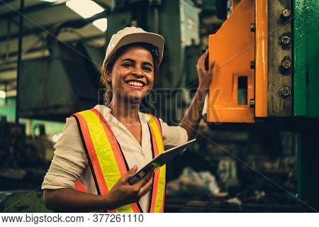 Portrait Of Industrial Worker Standing With Tablet Holding In Her Hand Feeling Proud And Confident L