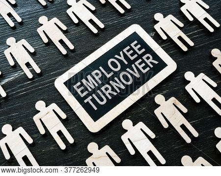 Plate With Words Employee Turnover And Figures.