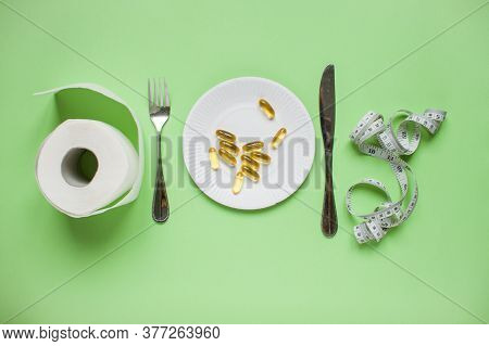 Diet And Healthy Eating Concept. Top View Of Weightloss. Green Apple, Measuring Tape, Knife With A F