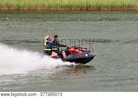 Mikolajki, Poland, July 12: Unidentified People On Water Scooter On July 12, 2020 At Mikolajki, Pola