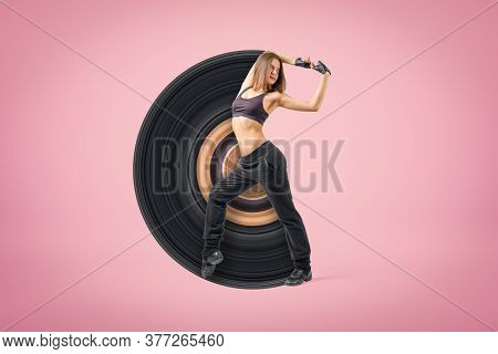 Young Sporty Woman Dancer Wearing Black Outfit On Pink Background