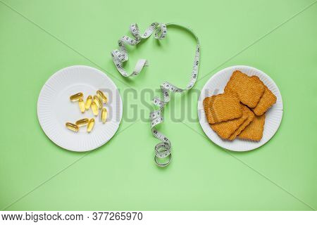 Diet And Healthy Eating Concept. Top View Of Weightloss. Choose Between Diet Pills And Cookies. Ques