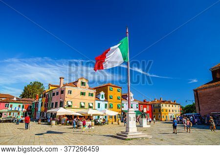 Burano, Italy, September 14, 2019: Burano Island Central Town Square With Old Colorful Buildings And