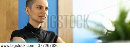 Portrait Of Happy Feminine Working At Home. Smiling Female Person Looking Away With Happiness And Ca